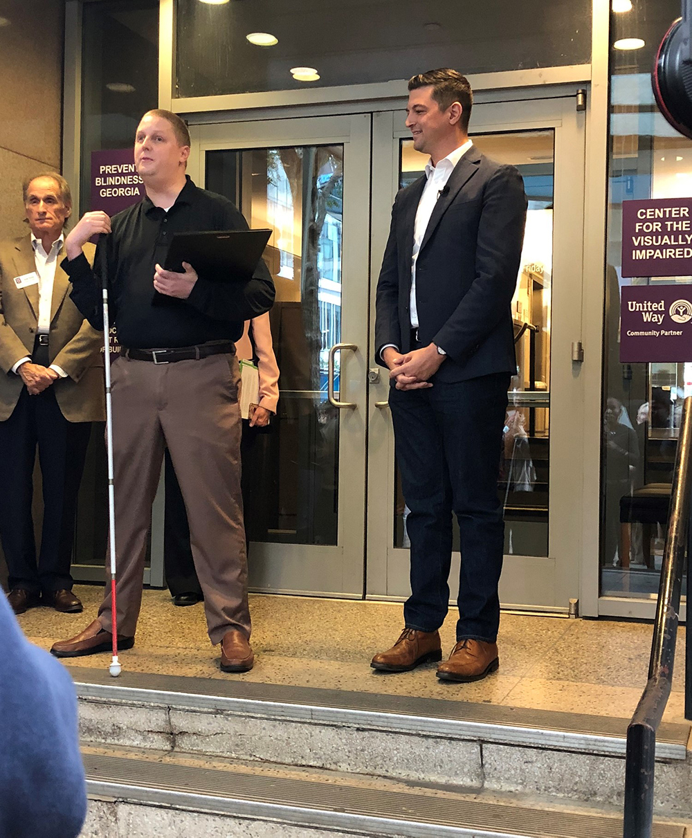 Center for the Visually Impaired former client and current employee Adam Hinchliffe introduces City Council Member Amir Farokhi in October 2019, when Farokhi issued a proclamation to declare Oct. 15 White Cane Awareness Day.